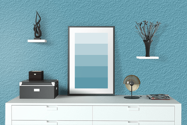 Pretty Photo frame on Blue Mist color drawing room interior textured wall