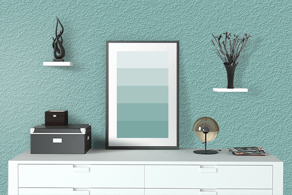 Pretty Photo frame on Muted Turquoise color drawing room interior textured wall