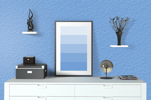 Pretty Photo frame on French Sky Blue color drawing room interior textured wall