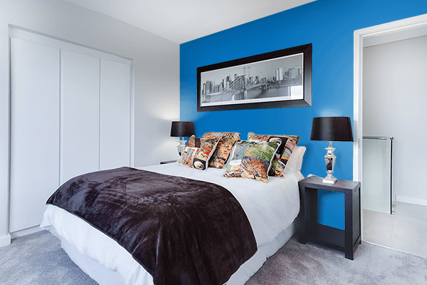 Pretty Photo frame on Spanish Blue color Bedroom interior wall color