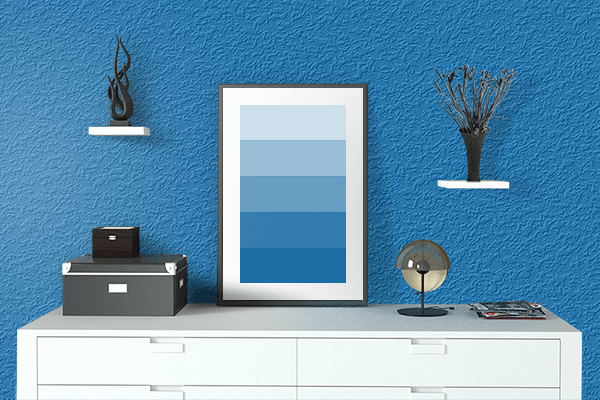 Pretty Photo frame on Spanish Blue color drawing room interior textured wall