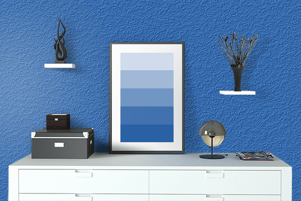 Pretty Photo frame on Denim color drawing room interior textured wall