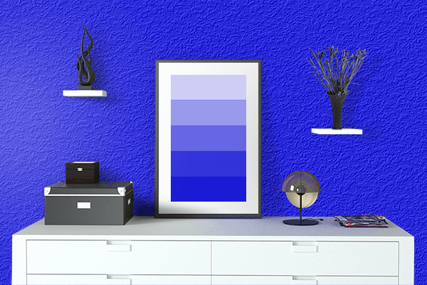 Pretty Photo frame on Pure Blue color drawing room interior textured wall