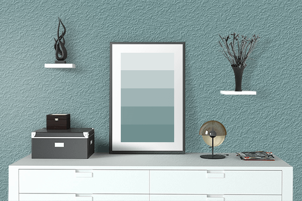 Pretty Photo frame on Dull Cyan color drawing room interior textured wall