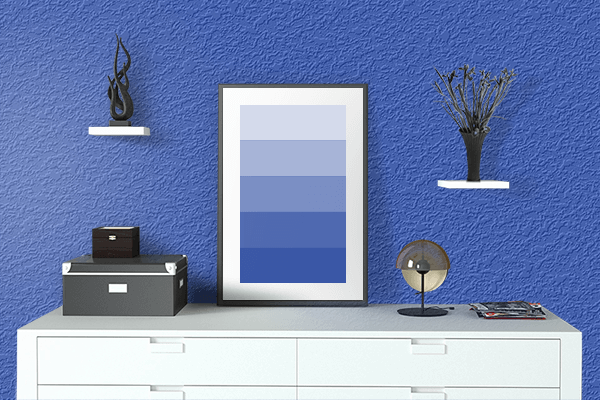 Pretty Photo frame on Cerulean Blue color drawing room interior textured wall