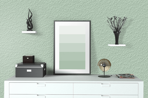 Pretty Photo frame on Celadon color drawing room interior textured wall