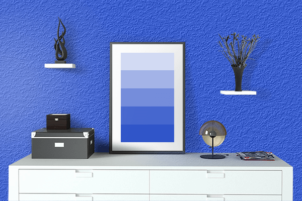 Pretty Photo frame on Palatinate Blue color drawing room interior textured wall