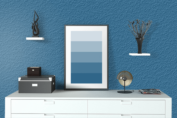 Pretty Photo frame on Lapis Lazuli color drawing room interior textured wall