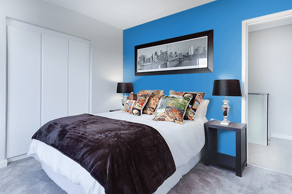 Pretty Photo frame on Cyan Cornflower Blue color Bedroom interior wall color