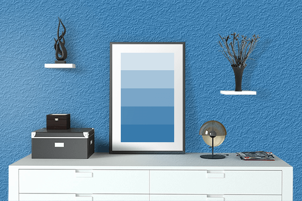 Pretty Photo frame on Cyan Cornflower Blue color drawing room interior textured wall