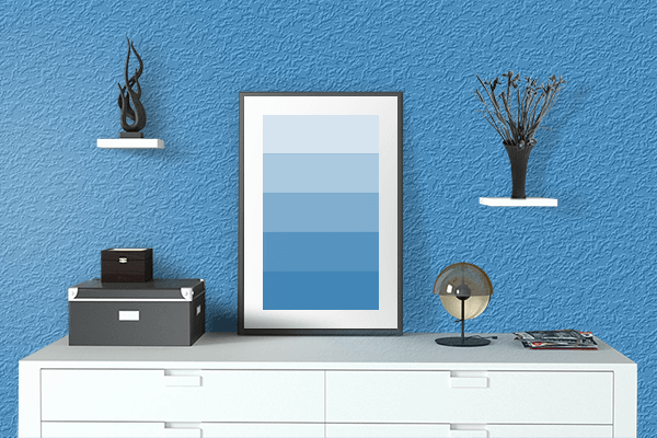 Pretty Photo frame on Tufts Blue color drawing room interior textured wall