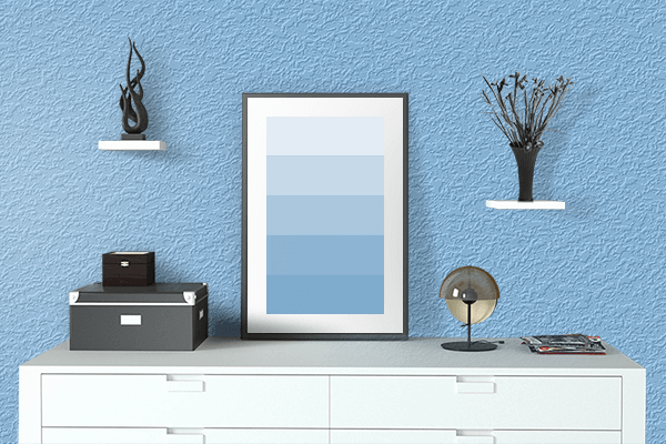 Pretty Photo frame on Baby Blue color drawing room interior textured wall