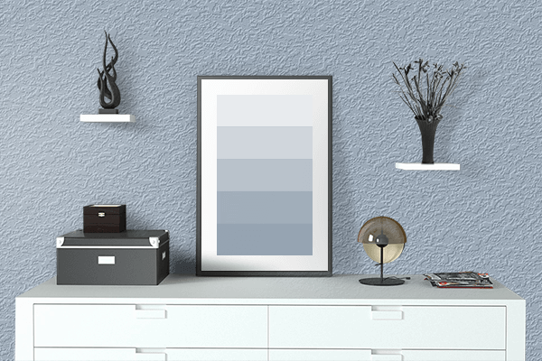 Pretty Photo frame on Pastel Blue color drawing room interior textured wall