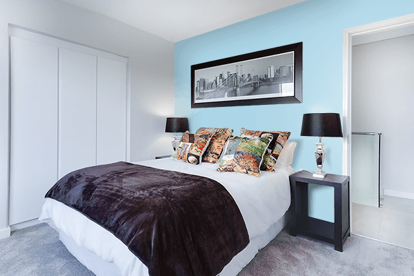 Pretty Photo frame on Light Blue color Bedroom interior wall color