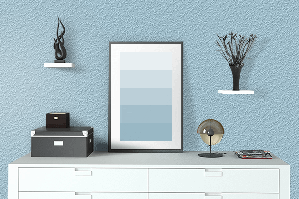 Pretty Photo frame on Light Blue color drawing room interior textured wall