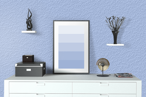 Pretty Photo frame on Pale Cornflower Blue color drawing room interior textured wall